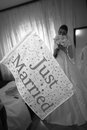 Just married bride holding her flower bouquet flag Stock Photography