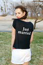 Just married bride in t shirt with caption Stock Images