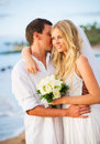 Just married couple on beach at sunset embracing the hawaii wedding Royalty Free Stock Photo