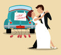 just married couple dancing and car