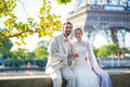 Just married couple drinking champagne beautiful near the eiffel tower Stock Images