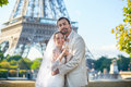 Just married couple drinking champagne beautiful near the eiffel tower Royalty Free Stock Images