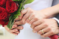 Just married couple hands with roses Stock Image
