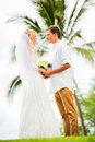 Just married couple holding hands intimate loving moment at wedding Stock Images