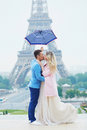 Just married couple near the Eiffel tower in Paris Royalty Free Stock Photo