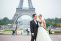 Just married couple in Paris near the Eiffel tower Royalty Free Stock Photo