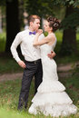 Just married couple in the park standing Royalty Free Stock Photo
