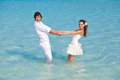 Just married couple in the sea Stock Photography