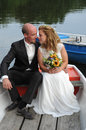 Just married couple together in a rowboat Royalty Free Stock Image