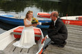 Just married couple together in a rowboat Royalty Free Stock Photos