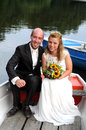 Just married couple together in a rowboat Royalty Free Stock Photography