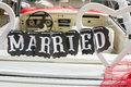 Just married note hanging from the car seat Royalty Free Stock Photo