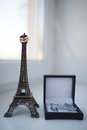 Just married in Paris. Two wedding rings on miniature Eiffel Tower Royalty Free Stock Photo