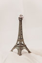 Just married in Paris. Two wedding rings on a miniature Eiffel Tower Royalty Free Stock Photo