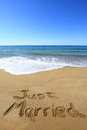 Just married written on golden sandy beach Royalty Free Stock Photos