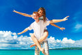 Just married young happy loving couple having fun on the tropical beach Royalty Free Stock Photo