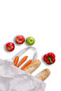 Just returned from grocery shopping with tote bag concept a white lying on its side fresh baguettes carrots red bell peppers Royalty Free Stock Image