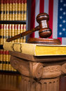 Justice gavel on greek column with american flag in the background Royalty Free Stock Photography