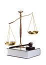 Justice golden scales of gavel and law book on a white background Stock Image