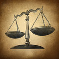 Justice scale grunge with texture as a symbol of law on a vintage parchment texture as a concept for the old legal system in Stock Image