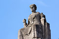 Justitia on Her Throne before a Clear Blue Sky Royalty Free Stock Images