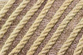 Jute rope on burlap background diagonally Royalty Free Stock Photos