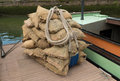 Jute sacks bale of waiting to be loaded in a boat Stock Images