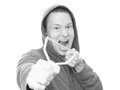 Juvenile crime monochrome version young angry man ready to fire his slingshot wearing a hooded jacket for concepts like Royalty Free Stock Image