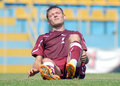 Juventus bucharest rapid bucharest s injured adrian grigore reacts after a fault during a friendly game between and Stock Photography