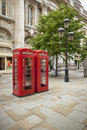 K booths two red phone on one of london s streets Royalty Free Stock Images