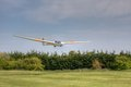 K21 Glider landing across trees Royalty Free Stock Photo