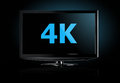 K television display with comparison of resolutions ultra hd on on modern tv Royalty Free Stock Photo