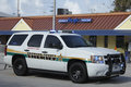 K unit broward county sheriff wilton manors florida june large white truck with its lights on parked at entrance to second day of Royalty Free Stock Image