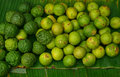 Kaffir Lime and Lime sold in Market on top of Banana Leaves Royalty Free Stock Photo