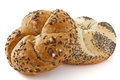 Kaiser bread rolls linseed roll with salt crystals and a white poppy seed roll Stock Photography