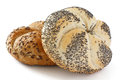 Kaiser bread rolls white poppy seed roll on white with a linseed roll Royalty Free Stock Photos