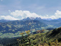 The kaiser mountains in tyrol austria view on peaks of and valleys forests and meadows sunny day autumn Stock Photos