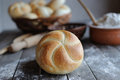 Kaiser roll fresh rolls on the rustic wooden table Stock Photos