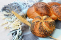 Kaiser roll and poppy seed braid with seeds braided bread on a table cloth Stock Image