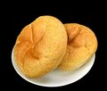 Kaiser rolls whole wheat on a black background Royalty Free Stock Photos