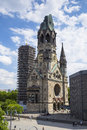 Kaiser wilhelm kirche in berlin germany broken spire and modern bell tower overlook the busy breitscheidplatz as symbols of the Royalty Free Stock Photography