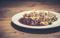 Kaiserschmarrn pancakes dessert served with plum compote