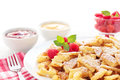 Kaiserschmarrn portion of fresh with sugar powder raspberries red fruit jelly and applesauce Stock Photo