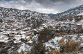 Kakopetria village during winter troodos cyprus mountain picturesque and famous of with snow covering the houses at mountain range Stock Photos