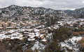 Kakopetria village during winter troodos cyprus mountain picturesque and famous of with snow covering the houses at mountain range Stock Image