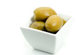 Kalamata green olives with water drops in white small bowl isola Royalty Free Stock Photo