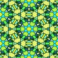 Kaleidoscope mosaic seamless pattern texture background in green, blue and yellow colors Royalty Free Stock Photo