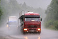 Kamaz chelyabinsk region russia july violet semi trailer truck at the interurban road during a heavy rainstorm Stock Photography