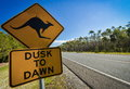 Kangaroo road sign next to a highway, Australia Royalty Free Stock Photo