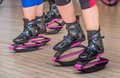 Kangoo jumps in aerobics room Stock Images